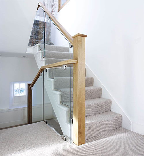 Delightful By Combining Cut String Glass And Oak, This Staircase Has Been Transformed  Into A Modern Masterpiece.